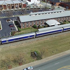 Aerial View of Amtrak #74 Carolinian Arriving & Departing Main St. Station - Burlington, NC