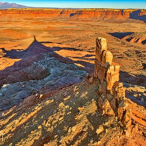 North Six-shooter Peak and its shadow at sunset, Indian Creek district near Canyonlands NP, Utah.