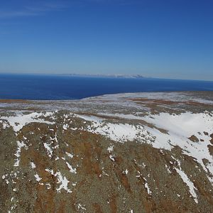Diomede Island - over the top - US Mainland in the bacground