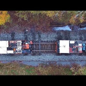 Aerial View of Railroad Spike Pullers/Inserters & Ballast Regulator at Work